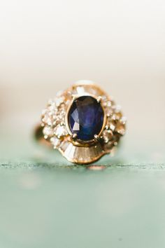 Oval Dark Sapphire & Double Baguette Halo: http://www.stylemepretty.com/2015/05/16/23-vintage-inspired-engagement-rings/