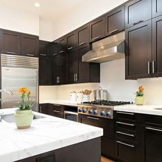 I like the set of shorter cabinets with another above it for extra storage.
