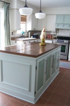 White kitchen with blue island - traditional - kitchen - other metro - Chris Kauffman.diy stove hood, blue hood painted same as blue island, color repeated in the drapes Kitchen Island Ends, Light Kitchen Cabinets, Old Kitchen, Farmhouse Style Kitchen, Kitchen Redo, Kitchen Remodel, Kitchen Ideas, Kitchen Counters, Farmhouse Ideas