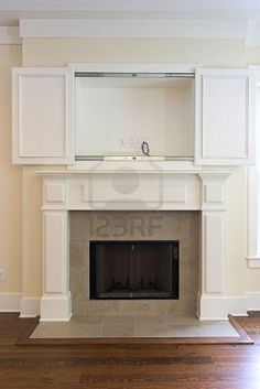 fireplace with open cabinet for flatscreen tv. Can be paired with other photo in this photographers gallery Stock Photo