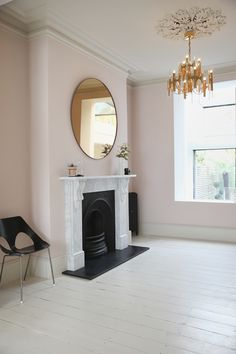 victorian living room, farrow & ball calamine walls, scolari light ,Harry Bertoia chair, rose gold mirror, carrara marble fireplace, ceiling rose,farrow & ball skimming stone floorboards, skimming stone.