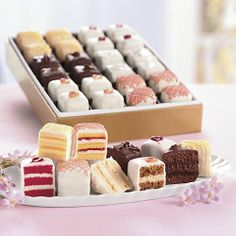 Swiss Colony's delicious flavors of Petits Fours Strawberry Shortcake, Lemon Mist, Chocolate Fudge, Carrot Spice. Plus, Royal Vanilla and Red Velvet hand-decorated Petits Fours Cupcakes, Cake Cookies, Cupcake Cakes, Cake Fondant, Petit Cake, Cake Recipes, Dessert Recipes, Small Cake, Mini Cakes