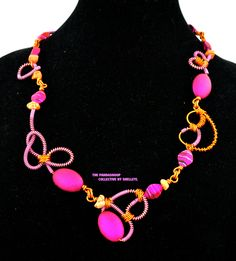 Swirl dream necklace in pink and orange.  A  fun, twisted aluminium necklace by ShelleyL and The Pandasnoop Collective by ShelleyLChalmers on Etsy