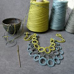 Crocheted cotton circles. Shades of green. Aliquid Textile Jewelry