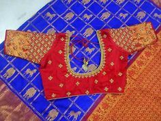 Beautiful royal blue color saree with horse and elephant design. Red color designer blouse with hand embroidery kundan work. Fancy Blouse Designs, Bridal Blouse Designs, Dress Designs, Designer Wear, Designer Dresses, Mom And Baby Dresses, Girls Dresses, Pattu Saree Blouse Designs, Work Blouse