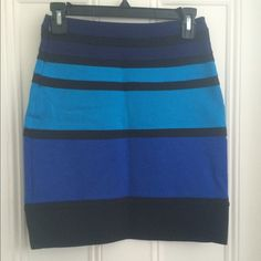 Express colorblock skirt High waisted blue colorblock skirt from Express! Great for work or going out! Goes with black, white, or any shade of blue! Hits just above the knee. Never worn!! Express Skirts Pencil