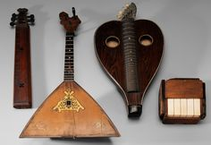 "Group of Four Antique Musical  Instruments - Lot 277 from July 2012 Auction. 18th and 19th centuries: epinnette des vosges, probably 18th century, 19-1/4 in., minor losses; Bavarian rosewood bowed zither, 19th century, 20-1/2 in., generally good condition; Russian inlaid balalaika, 19th century, 24-1/2 in., inlay and edge losses; digitarium marked ""Patent August 6, 1871"", 6-3/4 in., generally good condition.    Estimate $300 to $500."