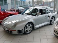 35. Porsche 959 (1986–1989)  An automotive icon of the'80s, the 959 featured ground-breaking technology from bumper to bumper, including a revolutionary all-wheel-drive system.