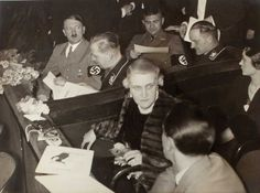 """A fantastic picture if only because of the lunatic look on Hitler's face. In the next box, Magda Goebbels, speaking to her husband, delivers an equally demented stare. Back in Hitler's box, the man in the rear left is Josef """"Sepp"""" Dietrich, one of Hitler earliest thugs, who rose to become one of the most celebrated Waffen SS field commanders."""