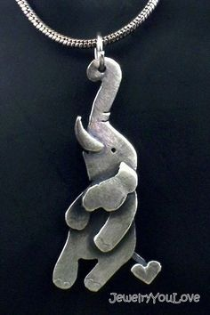 Sterling Silver Elephant Necklace - Taro. My FAV. :D This is too cute! I wish i could have this. . .