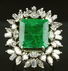 18K white gold, emerald and diamond ring,starburst pattern of diamonds surround…