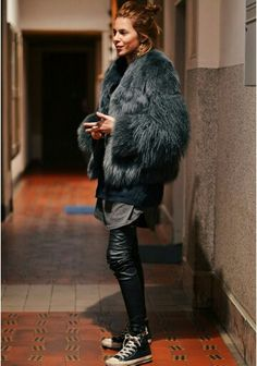 Sienna Miller (but I could be cross-eyed) wears a leather and faux fur outfit by MAJA WYH