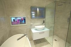 Add a bit of luxury into your bathroom with a flat screen television