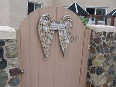 Angel wings on a gate.
