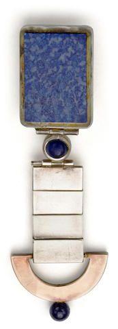 A Jean Despres silver, gilt and lapis lazuli pin