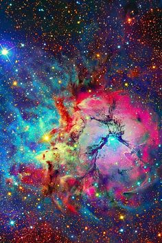 M20 / NGC 6514: Trifid Nebula in Sagittarius. Its name means 'divided into 3 lobes.' The object is an unusual combination of an open cluster of stars; an emission nebula; a reflection nebula  a dark nebula about 5200 ly away
