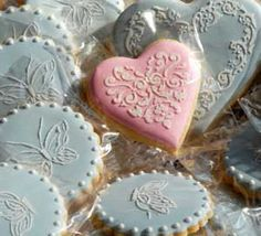 Stenciled Cookies - How to video, plus this site also sells the stencils.