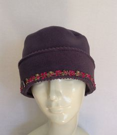 This little Grey Hat is made from the best quality polar fleece, milled in Massachusetts. This fleece is made from recycled plastic bottles. There are 3 layers that cover the ears, so this hat is as warm and practical as it is pretty. The hat is trimmed with a ribbon trim that is made in