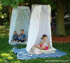 Hoola hoop and shower curtain made into a fort.