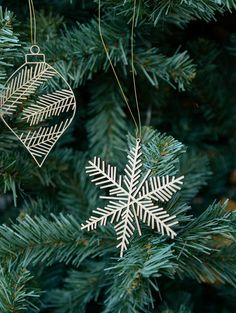 A set of two stunning, wooden laser cut ornaments. Delicate snowflake and classic Christmas Tree decoration shapes. 2d Christmas Tree, Natural Christmas Tree, Christmas Bedroom, Christmas Holidays, Christmas Ideas, Xmas, Christmas Ornaments, Wooden Christmas Decorations, Snowflake Decorations