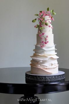 Wedding cake with ombre ruffles and fuchsia blossom. By Willemke Bulder.