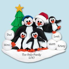 PENGUIN FAMILY of 4 HANDMADE Polymer Clay Personalized Christmas Ornament. $13.95, via Etsy.