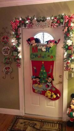 Mickey and Minnie Christmas door decor. Wow what a stocking. I love the plates. ask jen for oversize stocking Disney Christmas Decorations, Mickey Mouse Christmas, Christmas Themes, Christmas Crafts, Christmas Ornaments, Room Decorations, Mickey Mouse Wreath, Minnie Mouse, Christmas Sewing