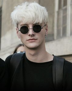 Bleached hair, sunglasses, septum ring, handsome man.