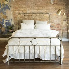 Daydream about crawling into this beautiful queen bed at the end of a long day