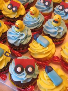 Little boy baby shower cupcakes... fondant duckies, bottles and wagons