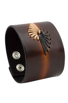 If you feel you would like to fly then this is the bracelet for you. The wide brown leather band has been intricately decorated with two wings. Each wing has been stitched with black and white leather thread. You can adjusted this winged bracelet to fit your wrist.  Category Page: https://bkkjewelry.com/en/10076-wide-leather-bracelets