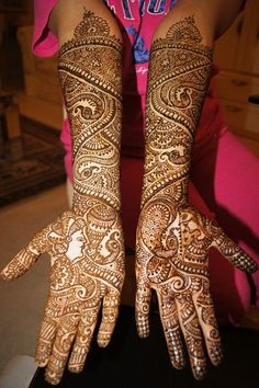 This phenomenal mehndi artist shows off her spectacular henna designs for our annual contest!