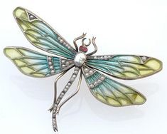 German Art Nouveau dragonfly brooch by Heinrich Levinger, Pforzheim, of 900 silver, plique-à-jour enamel, and seed pearls, ca. 1900-1910.