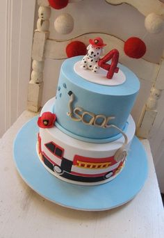 Fire Truck Cake Consider a traditional cake with a fire truck pictured on the side. Cute how the fire hose spells out the name