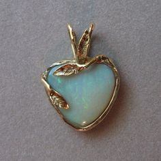 Australian Opal Heart Pendant set in 14K gold
