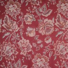 This is a garnet red floral brocade with sage green flowers and stems. The ground has a very defined rib. Very soft, great for Upholstery.