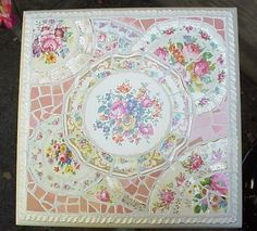 Oh my! Got to make this!! Table top made of broken china dishes!  This site is a wealth of information on broken china mosaics. Would love to try this someday...