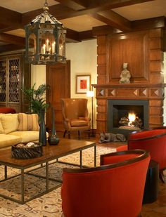Eberlain Design - Interior Designer - Philadelphia - Contemporary - Living Room - Cozy - Neutrals - Warm - Wood - Red - Rug - Printed Rug - Upholstered Chair - Coffee Table - Sofa - Throw Pillows - Lantern - Candles - Ceiling Lights - Paneled Ceiling - Wood Fireplace - Fireplace - Wood Floor - Display Cabinet