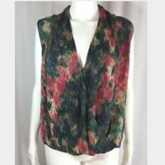 """Haute Hippie Silk Blouse S Gorgeous Haute Hippie top, size small. Green and red print, crossover front. Sleeveless. Excellent condition--no signs of wear. Smoke free home. Length: 22"""" armpit to armpit: 18"""" Haute Hippie Tops Blouses"""