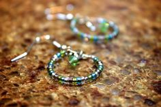 Green Sarovski Crystal Surround by Seed Beads Earrings