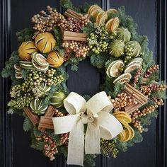 Wreaths are a classic Christmas tradition and they're great fun to make! Here's a list of over 80 beautiful Christmas ideas. Christmas Door Wreaths, Christmas Door Decorations, Rustic Christmas, Christmas Time, Christmas Crafts, Holiday Decor, Christmas Reef, Traditional Christmas Tree, Christmas Flowers