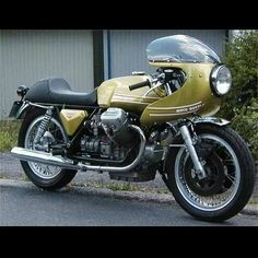 Moto Guzzi V7 Sport with half fairing option and single seat.