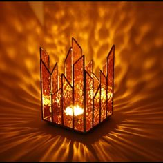 Pretty-looking amber candle holder. Wouldn't be too hard to replicate if you know a little bit about Tiffany style stained glass.