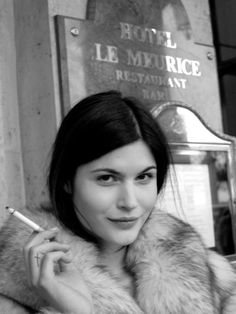 little to no makeup + fur + cigarette