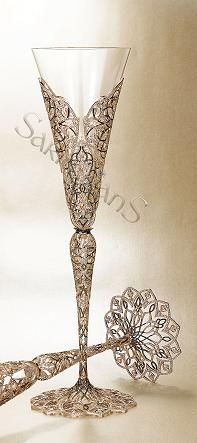 World's most expensive Champagne glass.... rose gold & diamonds.