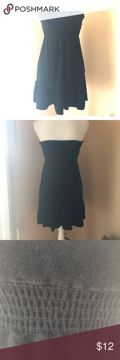 Bebe French Terry Ruffle Beach Dress Super cute beach dress/coverup. Black French terry material with elastic empire waist band, and ruffle hem. Strapless with pintuck in center of chest. Size Small. bebe Dresses Strapless