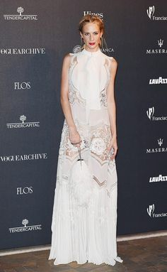 189d6f4f3e1a Poppy Delevingne wearing a beautiful white Roberto Cavalli gown with lace  cut-out panels at the Vogue Italia s anniversary party in Milan