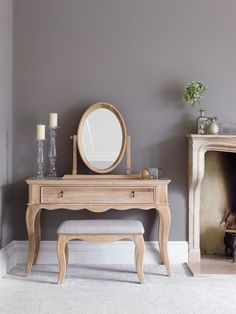 Inspired by a vintage French style, with curved detailing in a blend of solid oak and oak veneers, the Burleston Collection is ideal if you're looking for a genteel and traditional look. Sophisticated dressing table with elegant leg detailing, matching oval mirror and upholstered stool.