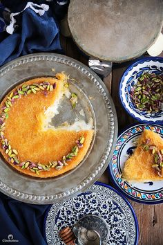 Mozarella Cheese Kunafa - This recipe breaks some cheese Kunafa-making rules, but the result is one of the best you'll ever have! A simple trick keeps the cheese filling from hardening even after it has cooled down. Arabic Sweets, Arabic Food, Arabic Dessert, Lebanese Desserts, Lebanese Recipes, Kunafa Recipe, Namoura Recipe, Arabic Recipes, Turkish Recipes