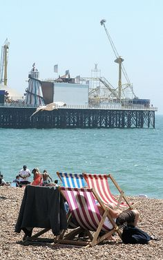 Deck Chairs on Brighton beach with the Palace Pier in the background Student Travel, Student Tours, British Seaside, British Summer, Beach Town, Beach Uk, Brighton And Hove, Uk Beaches, Travel List